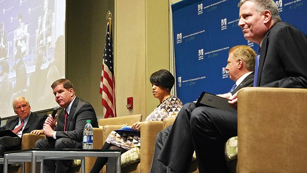 Mayor Martin Walsh speaks about financial empowerment strategies at UMass Boston last weekend. At left is moderator Eric Rosengren, President of the Federal Reserve Bank of Boston; the three other mayors featured at the public forum were (l-r) Stephanie Rawlings-Blake of Baltimore, Ed Murray of Seattle and Bill de Blasio of New York
