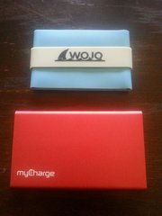 The Wojo Wallet is a very slim silicone, neoprene-lined sleeve that is water resistant and floats, and the myCharge RazorPlus is a fashionable, functional and lightweight phone charger crafted from anodized aluminum.