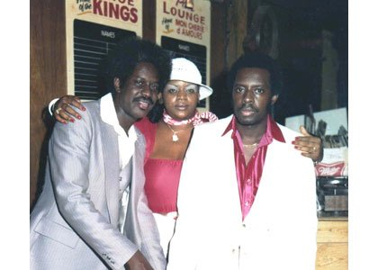 "Dave Brice, DJ Coffee, Walter ""Sam"" Williams in front of Pat's Lounge back in the day."