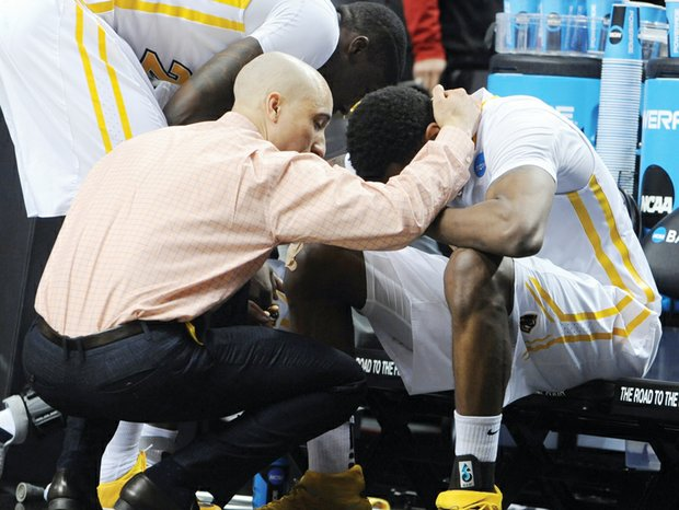 Virginia Commonwealth University Coach Shaka Smart consoles senior Treveon Graham after the team's 75-72 overtime loss in the NCAA Tournament to Ohio State University last Thursday.