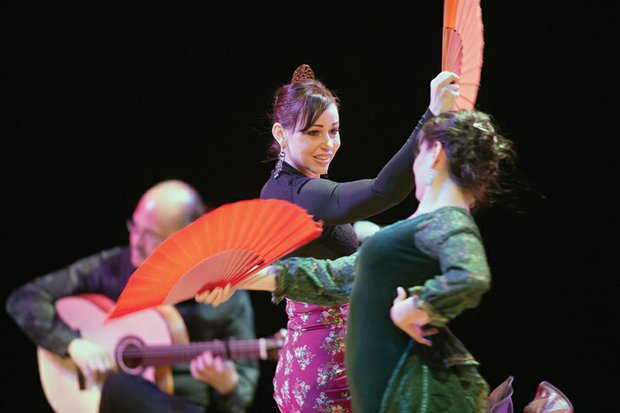 """Cori Bernal, left, and Ginette Perea dance the flamenco to the music of Spanish guitar maestro Michael """"Miguelito"""" Perez. They were among the crowd-pleasing artists who performed at the VCU Flamenco Festival V last Saturday. Location: The Singleton Center for the Performing Arts on the campus of Virginia Commonwealth University."""
