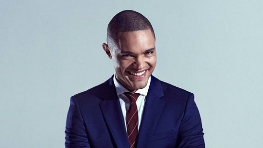 "A new satirical news era dawned on Monday night as Trevor Noah took over ""The Daily Show."" But before getting ..."