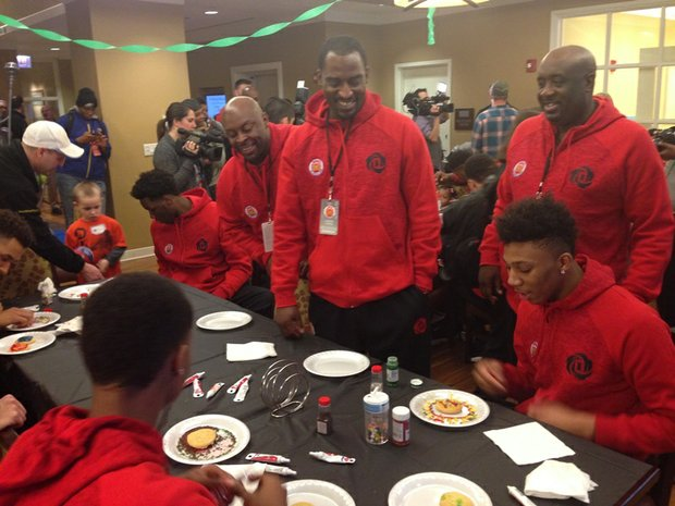 L-R  Simeon Career Academy coaches Fred Sculfield, Leonard Thomas and Robert Smith  share a laugh with McDonald's All American players as they decorate cookies at The Ronald McDonald House® of Chicagoland & Northwest Indiana, 211 E. Grand Ave.  Under the leadership of head coach, Robert Smith, Simeon Career Academy has won six Illinois High School Association champions.