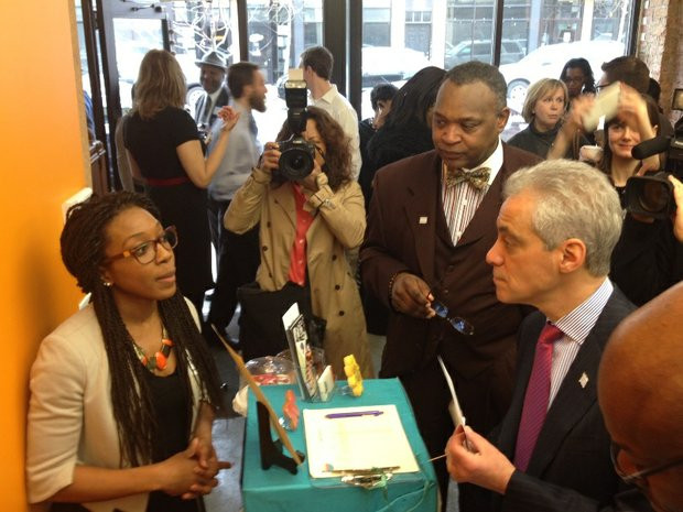 Rachel Bernier-Green, owner, Laine's Bake Shop, offered Chicago Mayor Rahm Emanuel a sample while discussing the benefits of Chicago's expanding Small Business Opportunity Center Program (SBOCP).