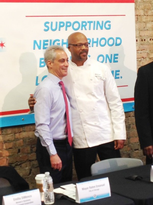 L-R Chicago Mayor Rahm Emanuel and Tsadakeeyah Emmanuel, owner of Majani Catering, 7167 S. Exchange Ave., pose before engaging in a roundtable discussion about Chicago's expanding Small Business Opportunity Center Program (SBOCP).
