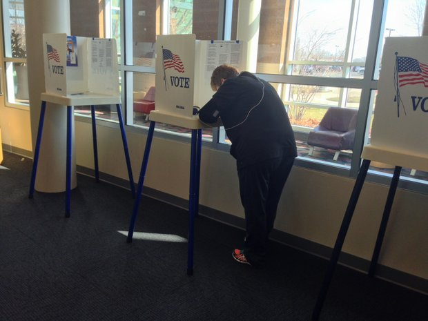 A Joliet resident casts an early ballot Wednesday at the Joliet Park District building at 3000 W. Jefferson St. Early voting continues through Monday.