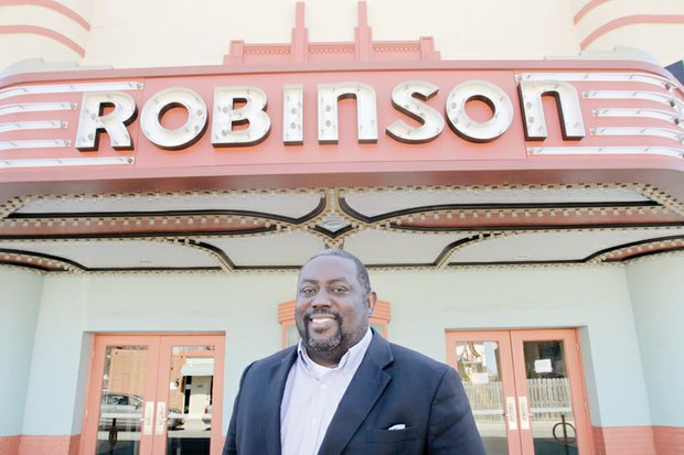 Pastor Donald Coleman stands in front of the Robinson Theater Community Arts Center, where the East End Fellowship he co-founded in 2008 worships each Sunday.