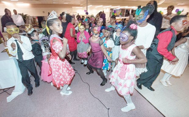 Students sporting colorful masks, tiaras and crowns hit the dance floor at the festive family event held at Second Baptist Church of South Richmond.