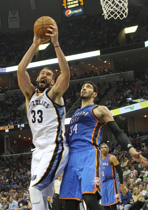 Marc Gasol of the Grizzlies grabs a rebound over Enes Kanter of OKC.