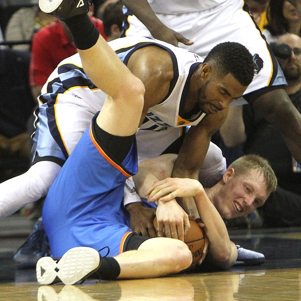 Grizz point guard Mike Conley (left) battles Kyle Singler of OKC for the loose ball.