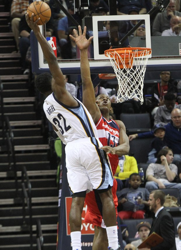 Memphis' Jeff Green dunks on Kevin Seraphin of the Wizards.