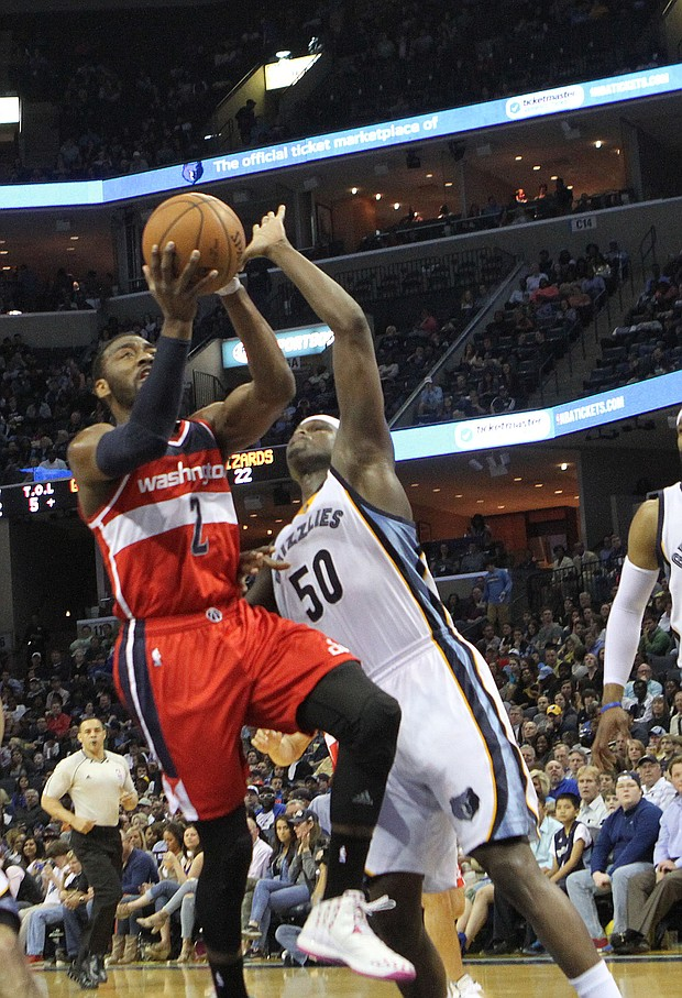 John Wall is determined to score against Zach Randolph of the Grizzlies.