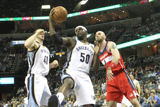 Zach Randolph grabs a rebound with teammate Kosta Koufas and Marcin Gorat of the Wizards reacting to his work.