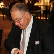 Baltimore Attorney A. Dwight Pettit signing his book.