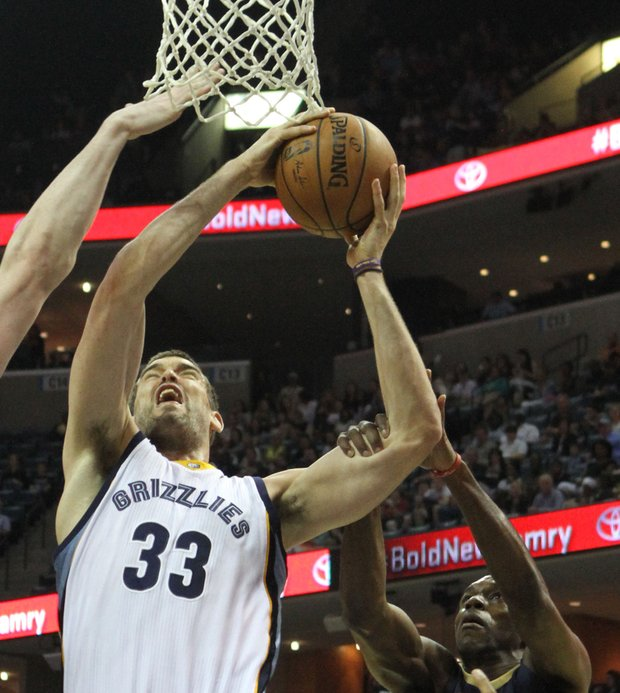 Marc Gasol, who helped set a strong tone early, powers his way up against former Grizz Quincy Pondexter.