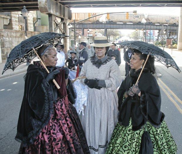 Mabel Gantt, left, Denise Benedetto and Malanna Henderson showcase Civil War-era dress