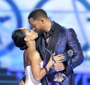 Will Smith presents an award to wife Jada Pinkett Smith during Black Girls Rock.