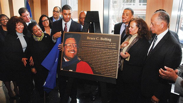 Bruce C. Bolling Jr. (7th from left) unveils his father's plaque at dedication ceremonies of the Bruce C. Bolling Municipal Building, April 7, 2015, surrounded by Bolling family members and Boston mayor Martin J. Walsh (3rd from left)