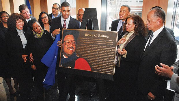 Bruce C. Bolling Jr. (7th from left) unveils his father's plaque at dedication ceremonies of the Bruce C. Bolling Municipal Building, April 7, 2015, surrounded by Bolling family members and Boston mayor Martin J. Walsh (3rd from left).