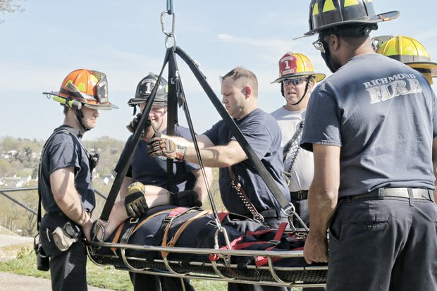 Richmond firefighters from Engine and Truck Company No. 1 take advantage of the spring weather to train in rescue methods last Saturday. Location: Chim- borazo Park in the city's East End near the fire station at 308 N. 24th St. The firefighters practiced what is called a Stokes Basket Evolution, using the park's steep, hilly terrain to train in retrieving victims from hard-to-reach locations.