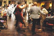 Guests dancing at the Billie Holiday 100th Birthday Celebrations at the historic Orchard Street Church.