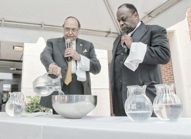 VUU President Claude G. Perkins and the Rev. W. Franklyn Richardson, chairman of the VUU Board of Trustees, conduct a libation ceremony honoring the university's forebearers.