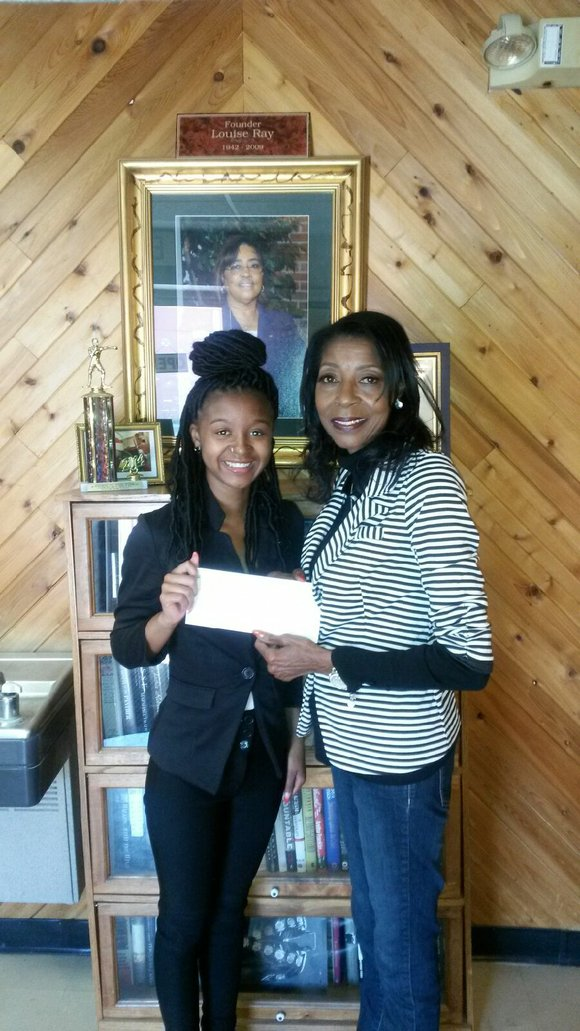Jayla Johnson, of Joliet, received $1,000 to continue her studies at Indiana State University.