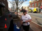 Gina Kappler, owner of The Gum Gal, works on gum removal as part of Plainfield's Lockport Street makeover.