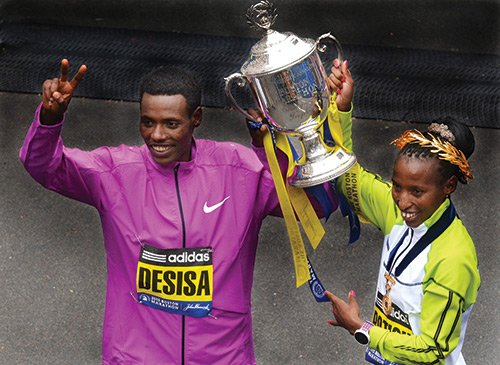 Winners of the 119th Boston Marathon, Lelisa Desisa (left) from Ethiopia, and Caroline Rotich, from Kenya. Desisa won the men's title with a time of 2:09:17 while Rotich won the women's title with a time of 2:24:55.