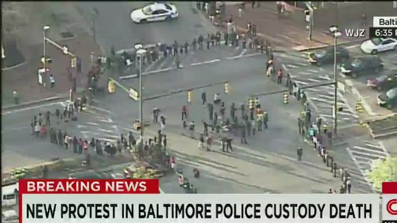 Baltimore protesters block major intersection.