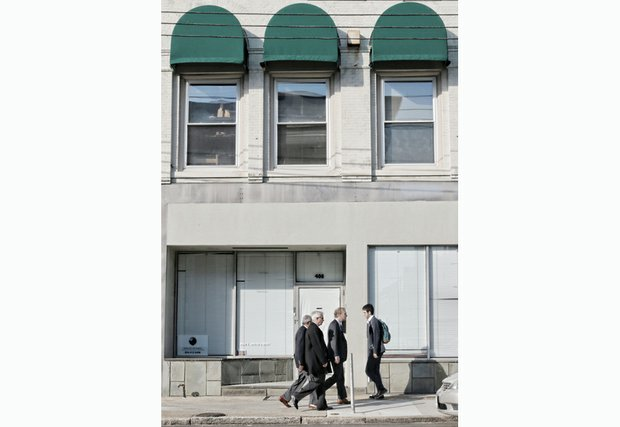 Pedestrians walk by the new home of Muhammad Mosque No. 24 at 408 E. Main St. in Downtown. No signs adorn the building to call attention to its new use as a place of worship.