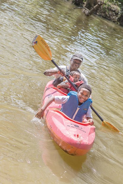 Earth Day fun Brothers Jamon, 9, and Justin Jones, 2, enjoy a kayak ride as their grandfather, Wayne Samuels, provides paddle power. The family fun took place last Saturday on the James River at Great Shiplock Park in Shockoe Bottom during activities at the city's annual Earth Day celebration. The actual worldwide Earth Day was April 22 and is designed to foster environmental protection.