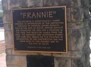 "The plaque providing the history of ""Frannie's Fountain"" remains despite the fact that the water display has been shut down."