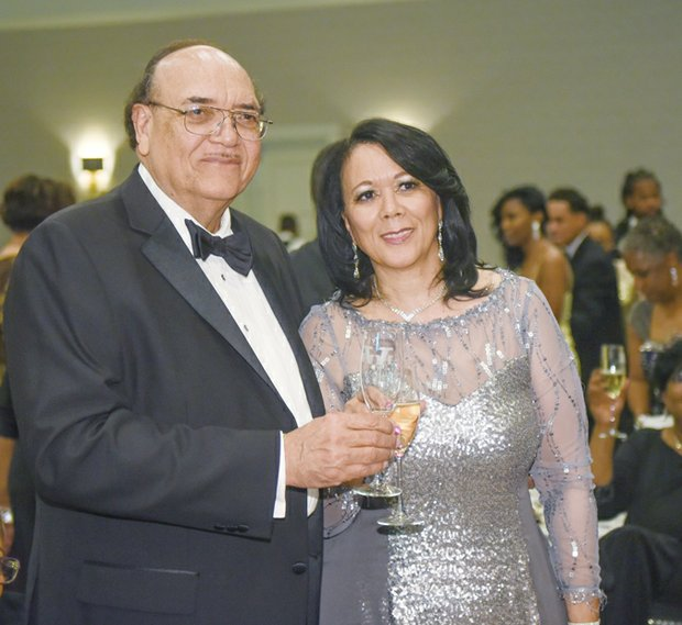 Virginia Union University President Dr. Claude G. Perkins and his wife, Cheryl E. Perkins, enjoy festivities at the VUU Scholarship Gala and Masquerade Ball. The black- tie fundraiser was held April 24 at a Downtown hotel.
