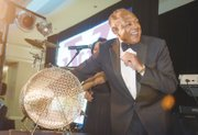 Mayor Dwight C. Jones, a VUU alumnus and official host of the event, draws the name of the winner of the 2015 BMW during the National Alumni Association's raffle during the gala.