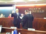 New Plainfield Village Board Trustee Ed O'Rourke is sworn in by Will County Judge Dan Rippy, a former board trustee.