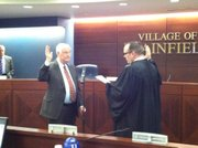 Bill Lamb started his third term on the Plainfield Village Board Monday night after being sworn in by Judge Dan Rippy.