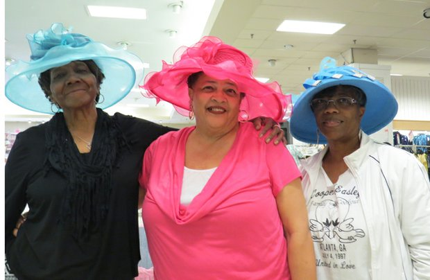 Jennifer Simpson (center) took first place in a bright pink hat from Macy's Spring Collection. Second place went to Sarah Height (left), and Jean Freeman finished third.