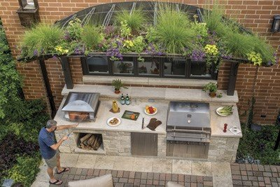 "Faulk, who also teaches outdoor kitchen design classes, said it is important to keep the cook in the party. ""It ..."