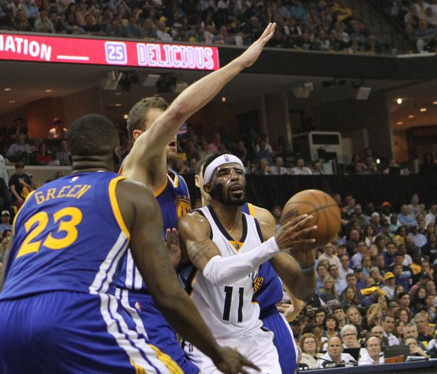 Double-teamed by Golden State's Draymond Green (left) and Andrew Bogut, Grizz point guard Mike Conley looks for the pass option. Memphis lost Game 4 101-84.