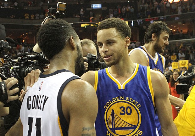Grizz point guard Mike Conley congratulates the Warriors' point guard Stephen Curry after Golden State won Game 6 and closed out the semifinal.