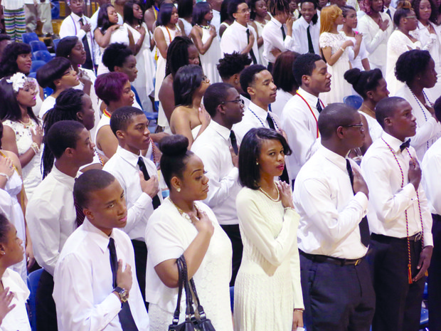 Southwest DeKalb chose to forego traditional caps and gowns for their pre-commencement, going with white shirts and dresses instead.