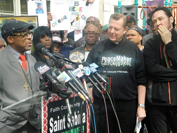 "L-R Academy Award nominated director Spike Lee, Faith Community of St. Sabina Pastor Father Michael Pfleger, and actor John Cusack gathered alongside several Englewood community stakeholders in support of Lee's upcoming film, ""Chiraq"" at St. Sabina, 1210 W. 78th Pl."
