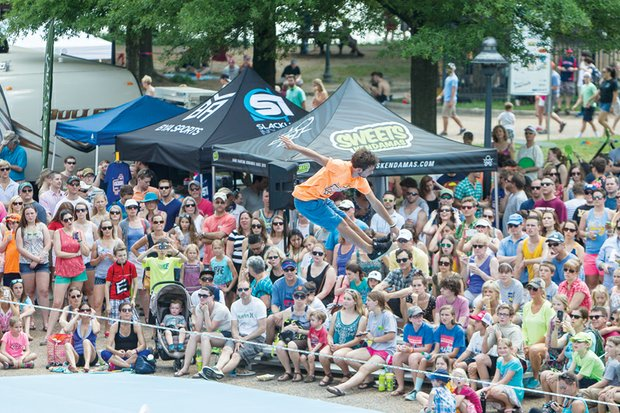 """Fun along the riverfront for people and pets — that's Dominion Riverrock. The three-day festival, billed as """"the nation's premier outdoor sports and music festival,"""" drew enthusiastic crowds who enjoyed everything from daredevil cyclists to trail runs and kayaking during the weekend. These scenes offer a taste of the activities: Emiliano Gimenez of Madrid, Spain, who is ranked No. 25 internationally by the World Slackline Federation, has an audience as he goes high on a slackline."""
