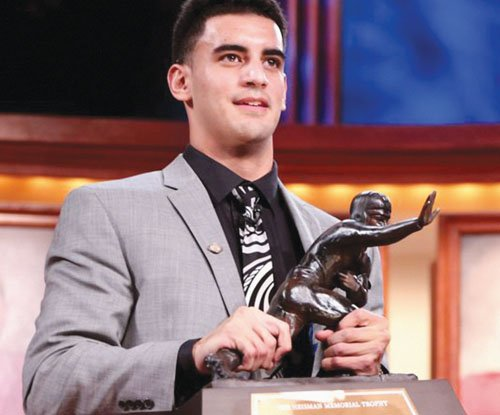 The 2014 Heisman Trophy, presented to the University of Oregon in recognition of the accomplishments of quarterback Marcus Mariota, will ...