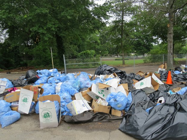 Piles of trash await pickup at the Festival Village, site of Saturday's Caribbean Carnival.
