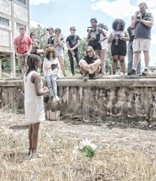 Darlene Scott, one of the event organizers, addresses the group after the Confederate flag was buried in a symbolic funeral Monday at Intermediate Terminal near the James River.