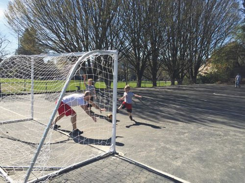 Portland Parks and Recreation dedicated a new futsal court, a version of soccer played on a smaller scale, at Colonel ...
