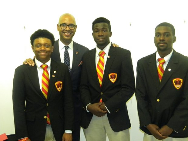 L-R Urban Prep Academy students Ronald Weaver, III; Jesse Olalusi, and Chandler Harrington joined Urban Prep Academy CEO/President/Founder Tim King (center) as he lobbied to renew the charters for Urban Prep Academy during a Chicago Board of Education meeting at Chicago Public School headquarters, 42 W. Madison Ave. in Chicago.