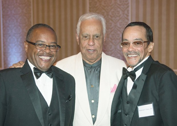 former Gov. L. Douglas Wilder, center, talks with the grandsons of an ODBA founder, Frederic Charles Carter Sr., at Saturday night's banquet. They are Scott H. Carter, left, and Frederic Charles Carter III.